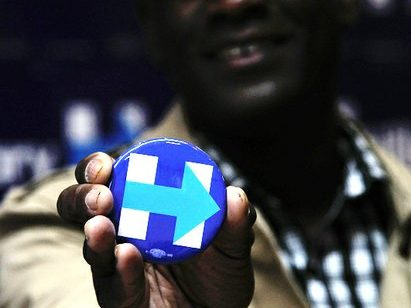 A volunteer displays a campaign button during the Hillary Clinton Campaign open house at 1227 Pennsylvania, Avenue SE on Wednesday, May 18th. /Photo by Patricia Little @5feet2