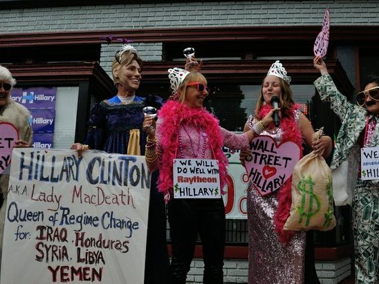 Code Pink activists perform anti-campaign satire during the Hillary Clinton Campaign open house at 1227 Pennsylvania Avenue, SE on Wednesday, May 18th. /Photo by Patricia Little @5feet2