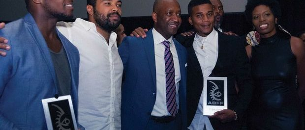 (left) Director/writer Qasim Basir; ABFF Founder Jeff Friday (center); and actor Cory Hardict (2nd from right). Basir receives award and $25,000 for best director and Hardict receives award for best actor during the Best of the Festival Awards Ceremony at the 20th Annual American Black Film Festival on Saturday, June 18 in Miami, FL. /Photo by Patricia Little @5feet2