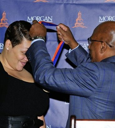 Morgan State University President Dr. David Wilson, places the Medal around Journalist Kirsten West Savali's neck. /Photo by Patricia Little @5feet2