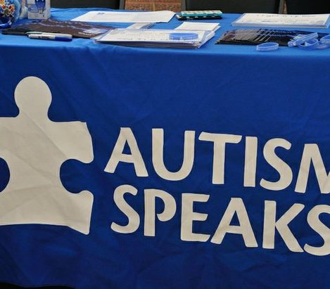 An table displaying literature, blue wristbands, light bulbs, and water bottles, were available to attendees during the Autism Speaks Light It Up Blue Event, at the THEARC, Saturday, April 2, 2016 in Southeast. /Photo by Patricia Little @5feet2
