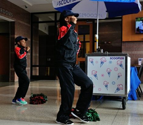 Students from the Malcolm X Elementary School pom pom squad provide entertainment during Autism Speaks Light It Up Blue event at the THEARC, Saturday, April 2, 2016 in Southeast. /Photo by Patricia Little @5feet2