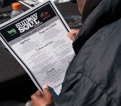 A guest looks over the menu during the Sunday Soul DC Pop Up Event at the New York Avenue men's shelter, Sunday, April 3, 2016 in Northeast. /Photo by Patricia Little @5feet2