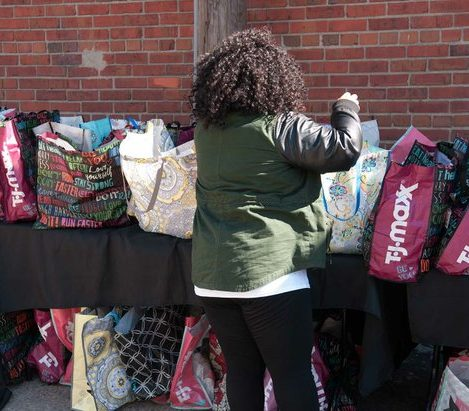 A volunteer assembles shopping totes filled with grooming items during the Sunday Soul DC Pop Up Event at the New York Avenue men's shelter, Sunday, April 3, 2016 in Northeast. /Photo by Patricia Little @5feet2