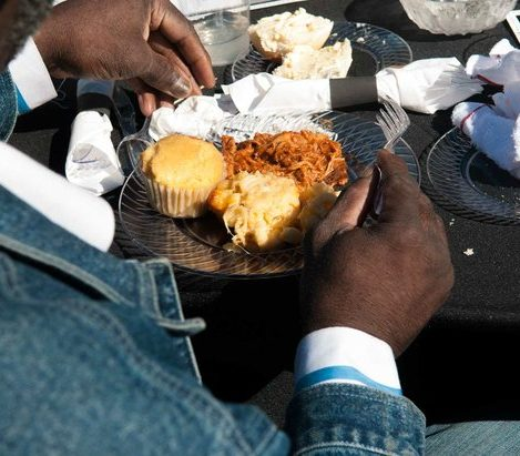 A guest dines on BBQ pork, macaroni and cheese, and a corn muffin during the Sunday Soul DC Pop Up Event at the New York Avenue men's shelter, Sunday, April 3, 2016 in Northeast. /Photo by Patricia Little @5feet2