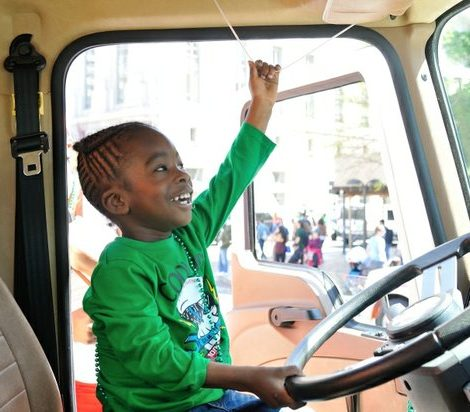 Cameron, a three year old DC native, pulls a cord to blow the truck's horn during the truck touch event at the Emancipation Day Parade on Saturday, April 16, 2016 in Northwest. /Photo by Patricia Little @5feet2