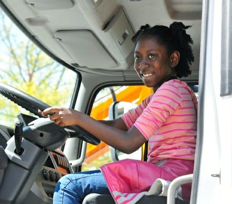 Nine year old Akilah, sits behind the steering wheel of a Mack cement truck during the truck touch event at the Emancipation Day Parade on Saturday, April 16, 2016 in northwest. /Photo by Patricia Little @5feet2