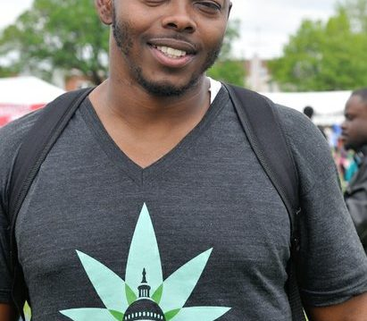 Massage therapist Purvis Rollins of Cannabispa attend the National Cannabis Festival on Saturday, April 23, 2016 at RFK Stadium in northeast DC. /Photo by Patricia Little @5feet2