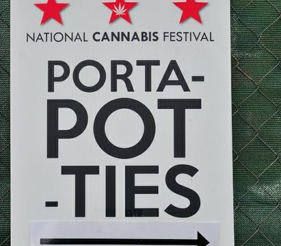 Festival signage displayed at the National Cannabis Festival on Saturday, April 23, 2016 at RFK Stadium in northeast DC. /Photo by Patricia Little @5feet2