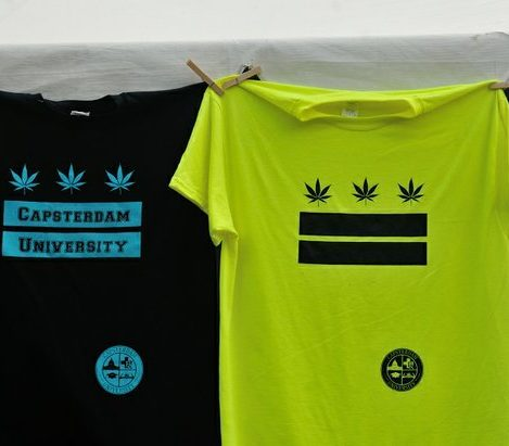 Tee shirts by Capsterdam University on display during the National Cannabis Festival on Saturday, April 23, 2016 at RFK Stadium in northeast DC. /Photo by Patricia Little @5feet2