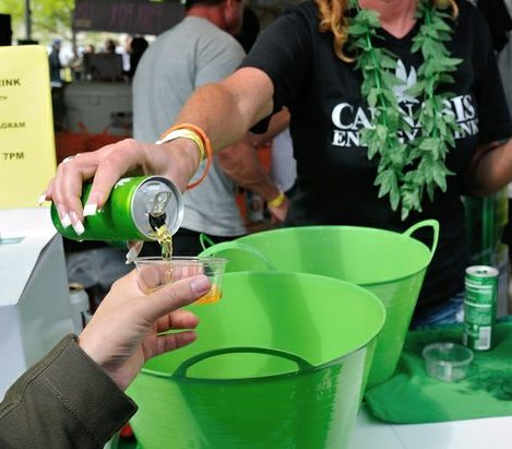 Patrons sample marijuana-laced energy drinks during the National Cannabis Festival, Saturday, April 23, 2016 at RFK Stadium. /Photo by Patricia Little @5feet2
