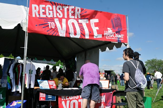The Head Count organization helps festival attendees register to vote during National Cannabis Festival, Saturday, April 23, 2016 at RFK Stadium. /Photo by Patricia Little @5feet2