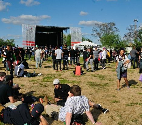 Festival attendees relax and enjoy concert music during the National Cannabis Festival, Saturday, April 23, 2016 at RFK Stadium. /Photo by Patricia Little @5feet2