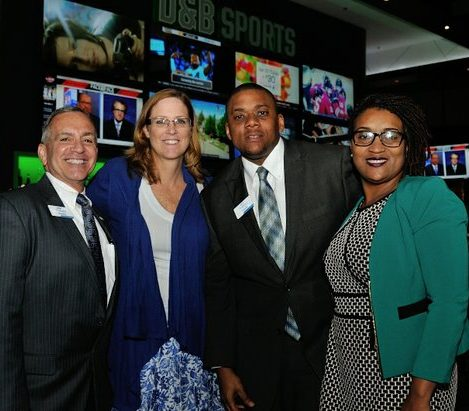 Stanley Koussis (left), Timothy Blue (center), and Tameyka Whitney (right) of Andrews Federal Credit Union attend the grand opening of Dave and Buster's restaurant, Monday, April 25, 2016 in Capitol Heights, MD. /Photo by Patricia Little @5feet2
