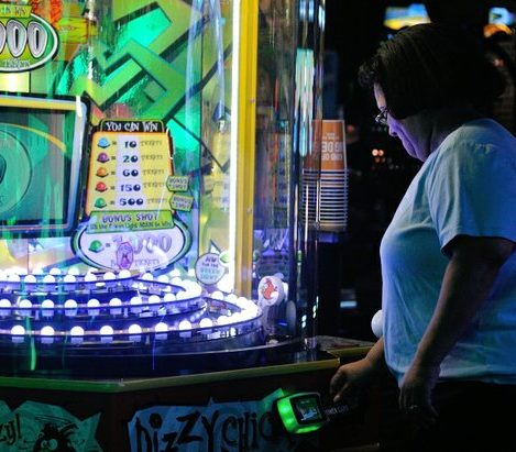 A patron prepares to play a game during the grand opening of Dave and Buster's restaurant, Monday, April 25, 2016 in Capitol Heights, MD. /Photo by Patricia Little @5feet2