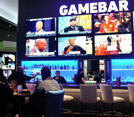 Patrons dine at the game bar during the grand opening of Dave and Buster's restaurant, Monday, April 25, 2016 in Capitol Heights, MD. /Photo by Patricia Little @5feet2