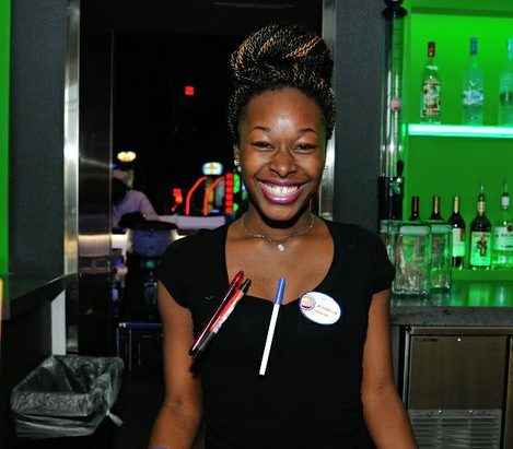 Bartender Icy is ready to serve guests during the grand opening of Dave and Buster's restaurant, Monday, April 25, 2016 in Capitol Heights, MD. /Photo by Patricia Little @5feet2