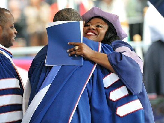 Queenate Chinweokwu Ibeto, D.D.S. Dentistry, embraces President Obama after delivering the welcome address during the 148th Commencement Convocation at Howard University on Saturday, May 7, 2016 in Northwest. /Photo by Patricia Little @5feet2