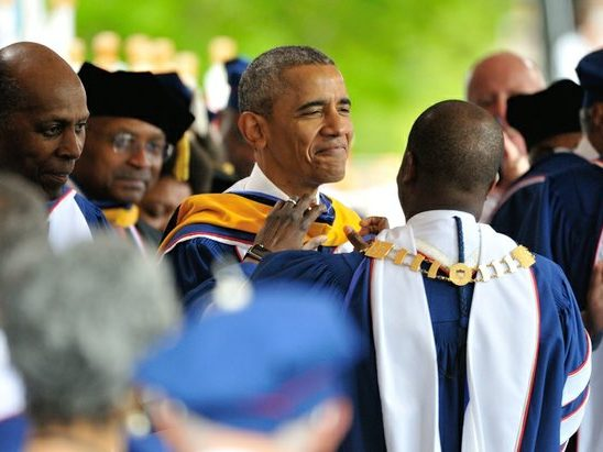 President Barack Obama humbly receives hood for the Degree of Doctor of Science during the 148th Commencement Convocation at Howard University on Saturday, May 7, 2016 in Northwest. /Photo by Patricia Little @5feet2