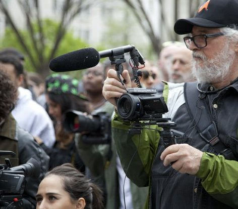 Activist videographer Eddie Becker captures the moments at the protest Saturday April 2, 2016. /Photo by Nancy Shia