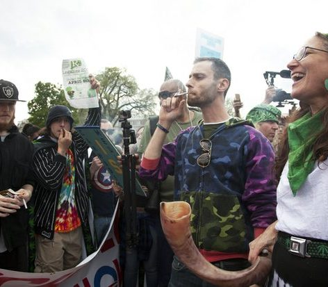 Celebrants dance and sing after 4:20 pm Saturday, April 2, 2016, in front of the White House during the civil disobedience action of smoking marijuana cigarettes, to bring attention to the need to de-schedule marijuana from being illegal. /Photo by Nancy Shia @nancy_shia
