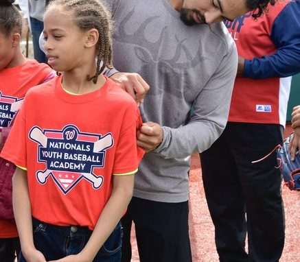 Rendon autographs one of the youth's academy t-shirt. /Photo by Travis Riddick @actor_TR