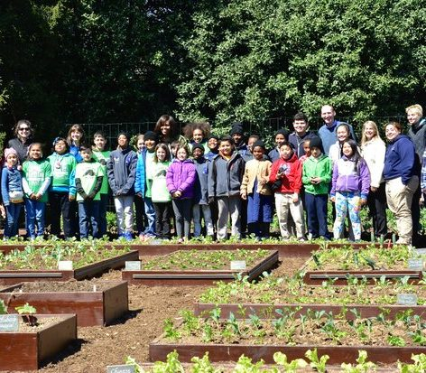 Students and other helpers overlook their finished work, planting the White House Kitchen Garden. For the last seven years, Mrs. Obama has made fresh fruits and vegetables an important part of her message, and here she looks at her last Kitchen Garden during her time at the White House. /Photo by Travis Riddick @actor_tr