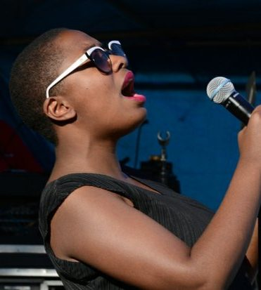 DC JazzFest: Cecile McLorin Salvant, sing one of her with great feeling for the crowd on on Saturday afternoon at the DC JazzFest in The Yards in Southeast DC. /Photo by Roy Lewis