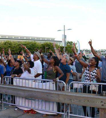 DC JazzFest: The crowd come to their feet when K K Brown and her brother Wiley tell them to get up, at the DC JazzFest at the Yards on Saturday June 18 2016 in Southeast DC. /Photo by Roy Lewis