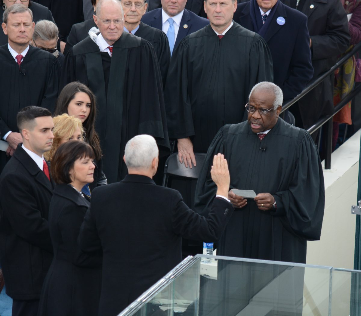 Supreme Court Justice Clarence Thomas administers the oath of office Administered to Vice President Michael R. Pence at the 58th Presidential Inaugural on January 20, 2017. /Photo by Roy Lewis