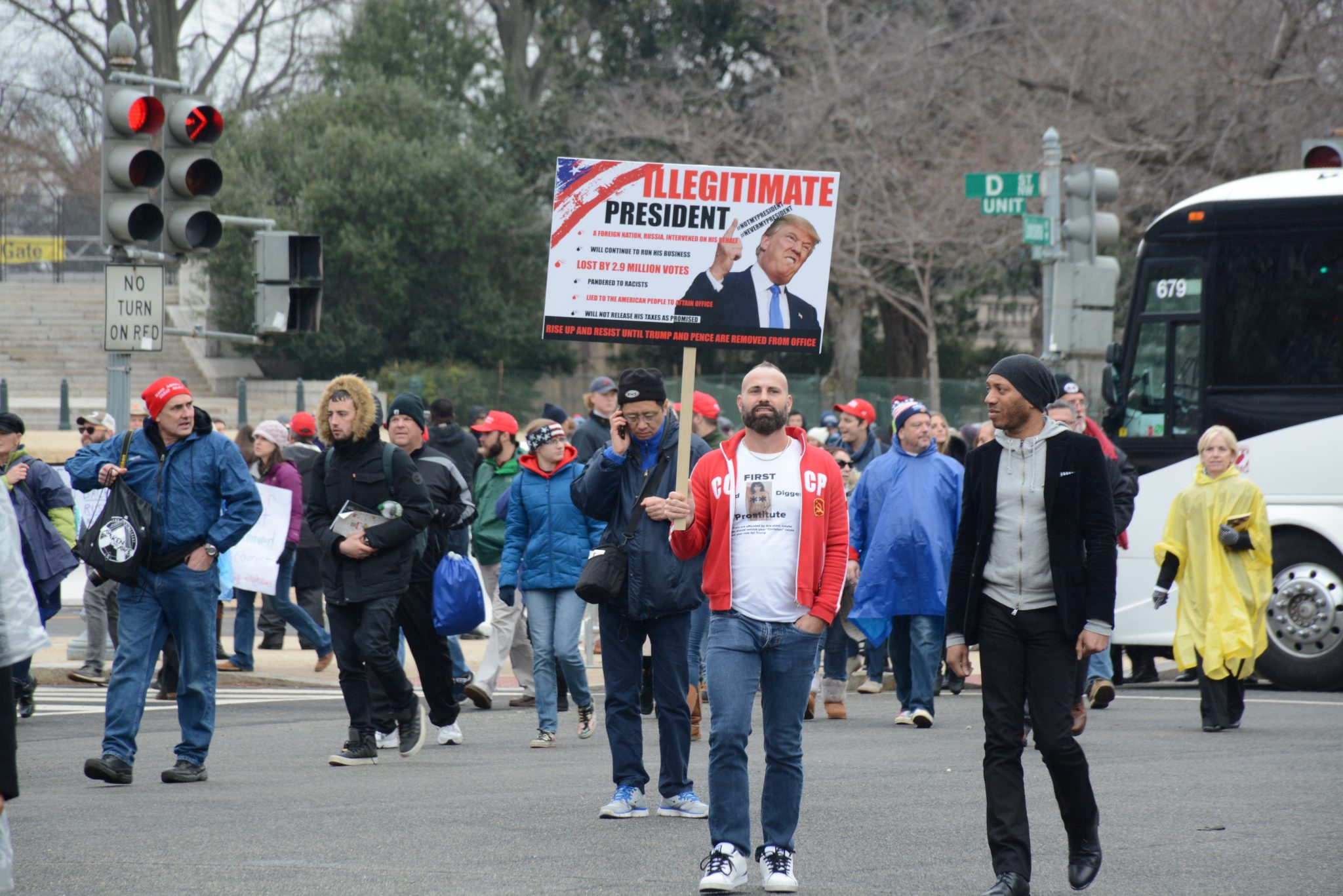 Protesters mixed throughout the crowd leaving the Capitol after the swearing-in of President Donald J. Trump on January 20, 2017. /Photo by Roy Lewis