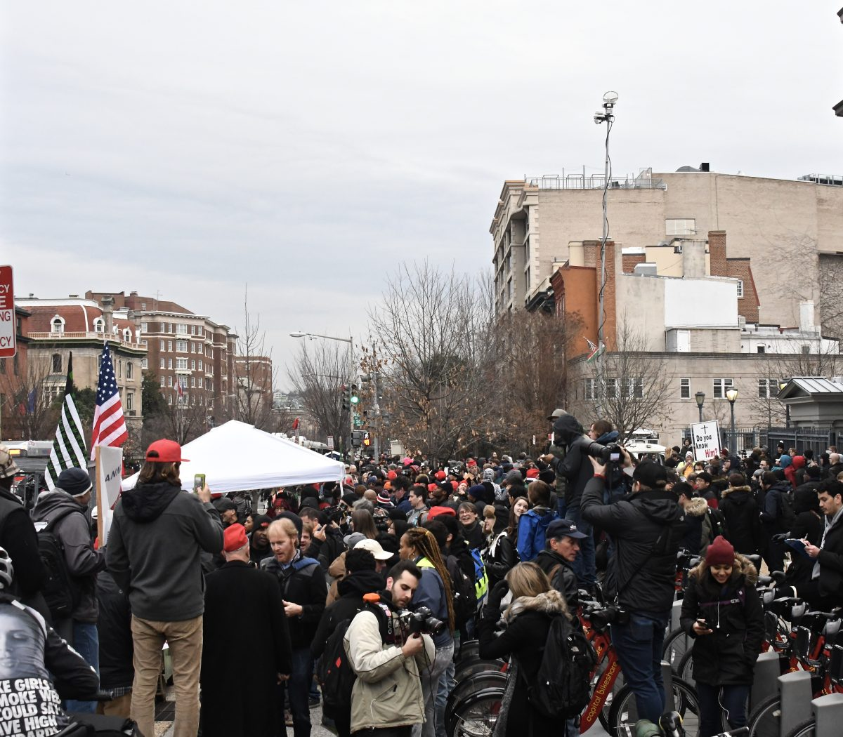 More than a thousand demonstrators rallied at 20th and Massachusetts Ave, NW in support of legalizing marijuana on the federal level and to protest President Trump's pick of attorney general Friday, Jan 20. Photo by Travis Riddick