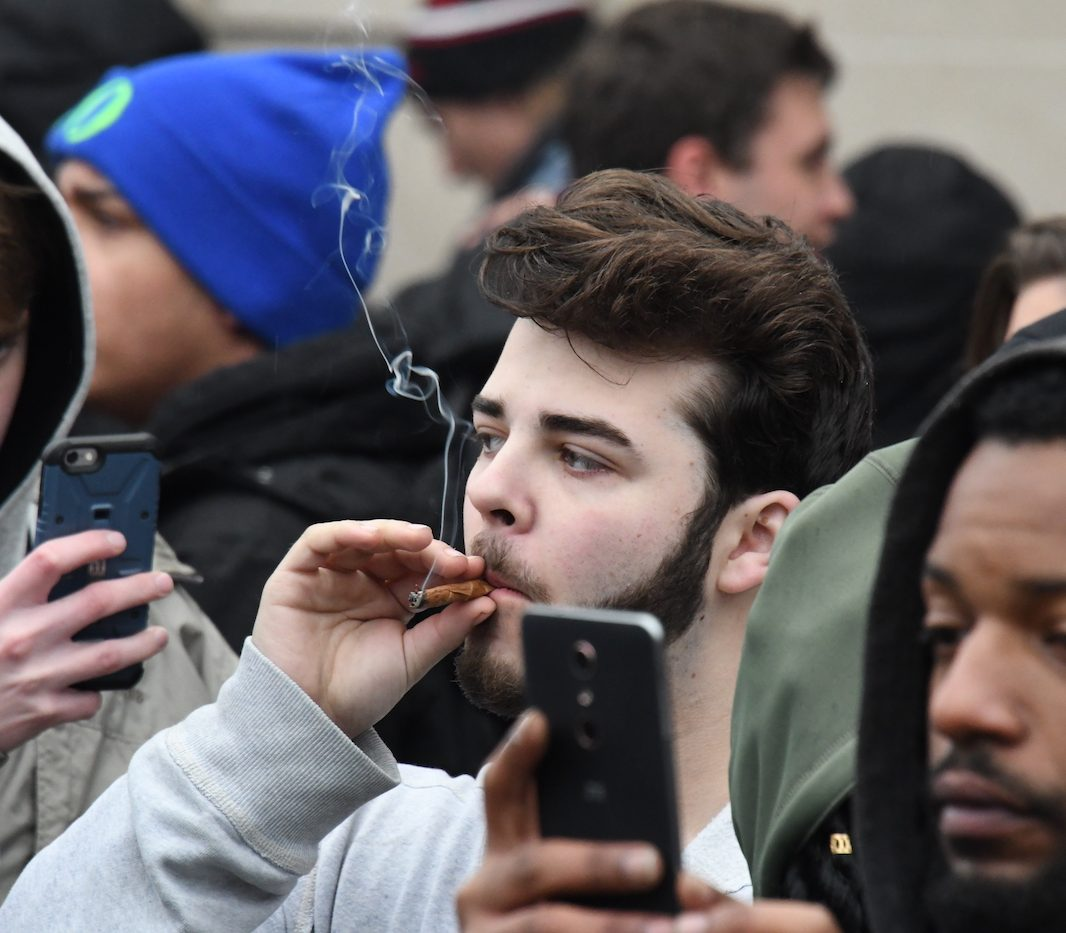 Hundreds of demonstrators rally at 20th Street and Massachusetts Ave in northwest D.C. in support of federally legalizing marijuana and in protest of Sen. Jeff Sessions, newly elected President Trump's pick of attorney general, on Jan 20. (Travis Riddick/The Washington Informer)