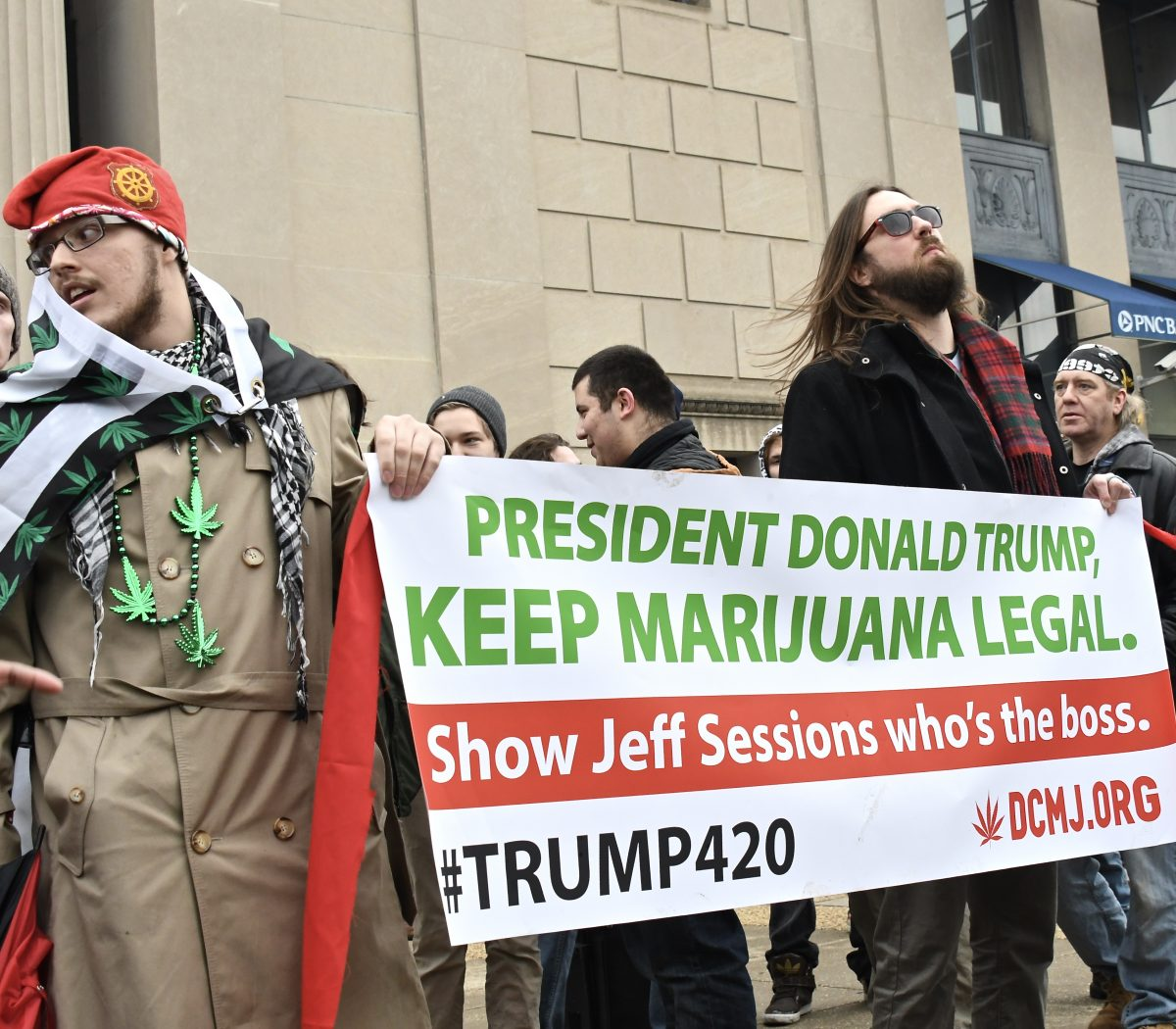 More than a thousand demonstrators rallied at 20th and Massachusetts Ave, NW in support of legalizing marijuana on the federal level and to protest President Trump's pick of attorney general Friday, Jan 20. /Photo by Travis Riddick