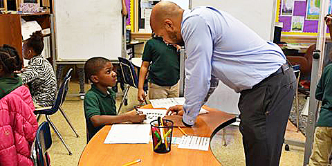 Brandon Johnson assists some of his students at Browne Educational Campus in Northeast. /Courtesy of DCPS via Facebook