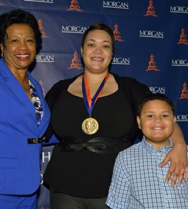 Morgan State University Provost Dr. Gloria Gibson (left), medal recipient and Journalist Kirsten West Saval (center) and son Dash (right) attend the Vernon Jarrett Medal of Honor Ceremony on Tuesday, June 28, 2016 at the National Press Club in Northwest. /Photo by Patricia Little @5feet2