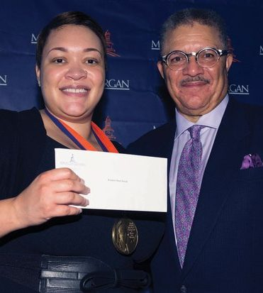 Dean and Professor of Journalism DeWayne Wickham (right), is proud to award Journalist Kirsten West Saval (left) with a medal and a $10,000 check for exemplary reporting on Black life in America during the Vernon Jarrett Medal of Honor Ceremony on Tuesday, June 28, 2016 at the National Press Club in Northwest. /Photo by Patricia Little @5feet2