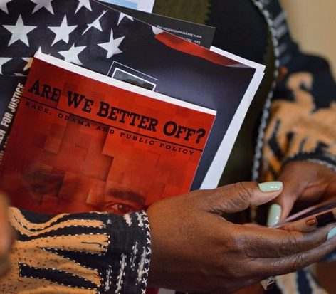 "An attendee waits to get an autographed copy of Dr. Julianne Malveaux latest book ""Are We Better Off? Race, Obama and Public Policy"", at the Sixth Annual Stateswomen for Justice Luncheon at the National Press Club, Thursday, March 31, 2016 in Northwest. /Photo by Patricia Little @5feet2"