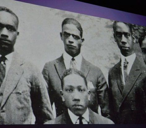 An archival photo of young black male students is shown during the world premiere screening of Dunbar, Thursday, March 31, 2016 at the E Street Cinema in Northwest. /Photo by Patricia Little @5feet2