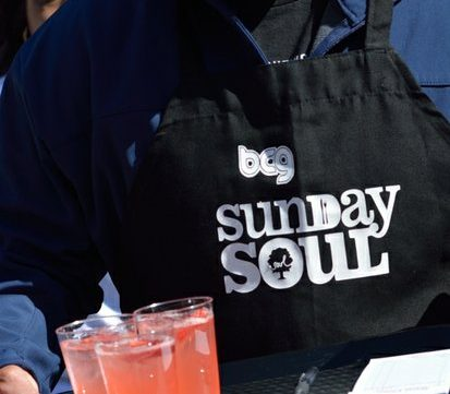A volunteer serves beverages to homeless residents during Sunday Soul DC Pop Up at the New York Avenue men's shelter, Sunday, April 3, 2016 in Northeast DC. /Photo by Patricia Little @5feet2