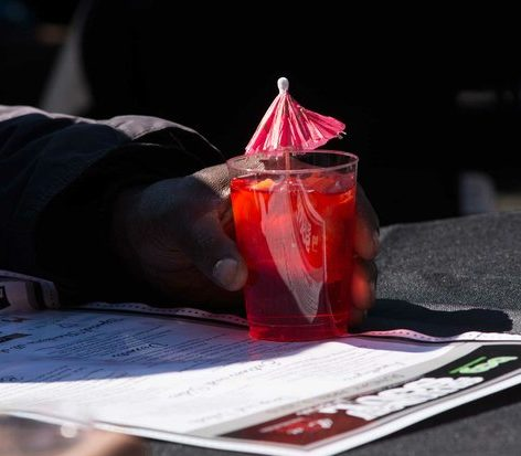 Fruit punch beverages, decorated with tiny umbrellas, are served to guests during the Sunday Soul DC Pop Up Event at the New York Avenue men's shelter, Sunday, April 3, 2016 in Northeast. /Photo by Patricia Little @5feet2