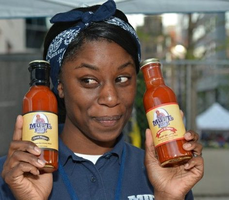 A representative for Mutts hot sauce serves salsa and chips samples during the Cherry Blast event on Saturday, April 16, 2016 at the Carnegie Library in northwest. /Photo by Patricia Little @5feet2