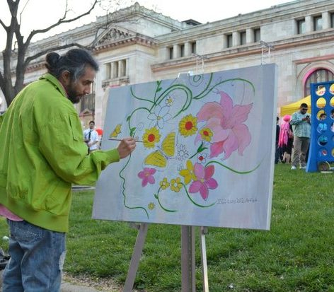 Artist Luis De Valle creates a cherry-blossom theme painting during the custom competition at the Cherry Blast event on Saturday, April 16, 2016 at the Carnegie Library in northwest. /Photo by Patricia Little @5feet2