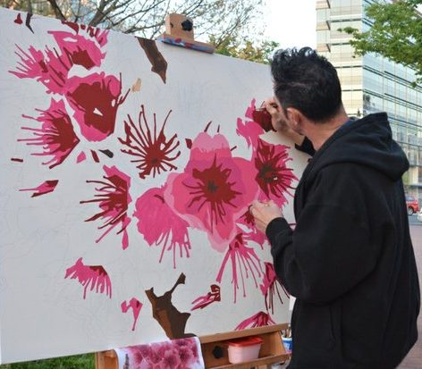 Artist David Amoroso creates a cherry-blossom theme painting during the custom competition at the Cherry Blast event on Saturday, April 16, 2016 at the Carnegie Library in northwest. /Photo by Patricia Little @5feet2