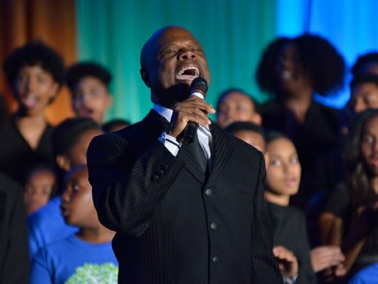 Wintley Phipps performs a musical selection with the DreamKids and the Takoma Academy Chorale during the 15th Annual Power of a Dream Gala on Tuesday, May 3, 2016 at the Renaissance Hotel in Northwest. /Photo by Patricia Little @5feet2