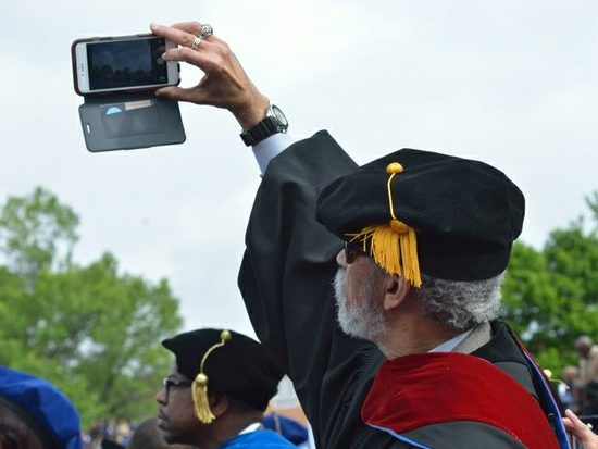 A faculty member takes a selfie during the 148th Commencement Convocation at Howard University on Saturday, May 7, 2016 in Northwest. /Photo by Patricia Little