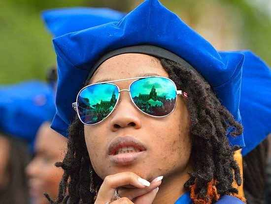 A student reflects on college life during the 148th Commencement Convocation at Howard University on Saturday, May 7, 2016 in Northwest. /Photo by Patricia Little