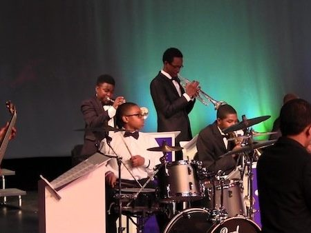 The FAME Jazz Band, led by renowned jazz pianist and composer Nat Adderley Jr., performs at Oxon Hill High School Vocal Music Department's Spring Concert on May 5.