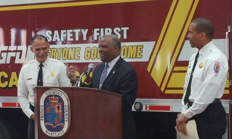 Prince George's County Executive Rushern L. Baker III (center) announces the retirement of Fire Chief Marc Bashoor (left) during a news conference at the St. Joseph Fire Station in Springdale on Jan. 6. Deputy Chief Benjamin Barksdale (right), who will serve as interim chief, is Baker's permanent selection for Bashoor's successor. (William J. Ford/The Washington Informer)