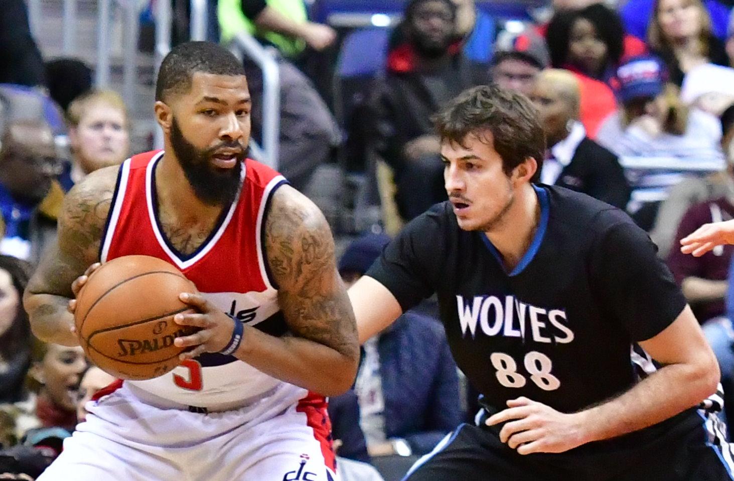 Washington Wizards forward Markieff Morris posts up against Minnesota Timberwolves forward Nemanja Bjelica in the first quarter of the Wizards' 112-105 victory at Verizon Center in northwest D.C. on Jan. 6. (John De Freitas/The Washington Informer)